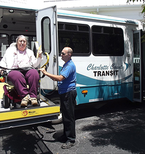 Charlotte County Transit - operator assisting passenger on a lift